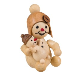 Schneemädchen mit Puppe