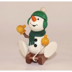 Schneemann auf Schlitten